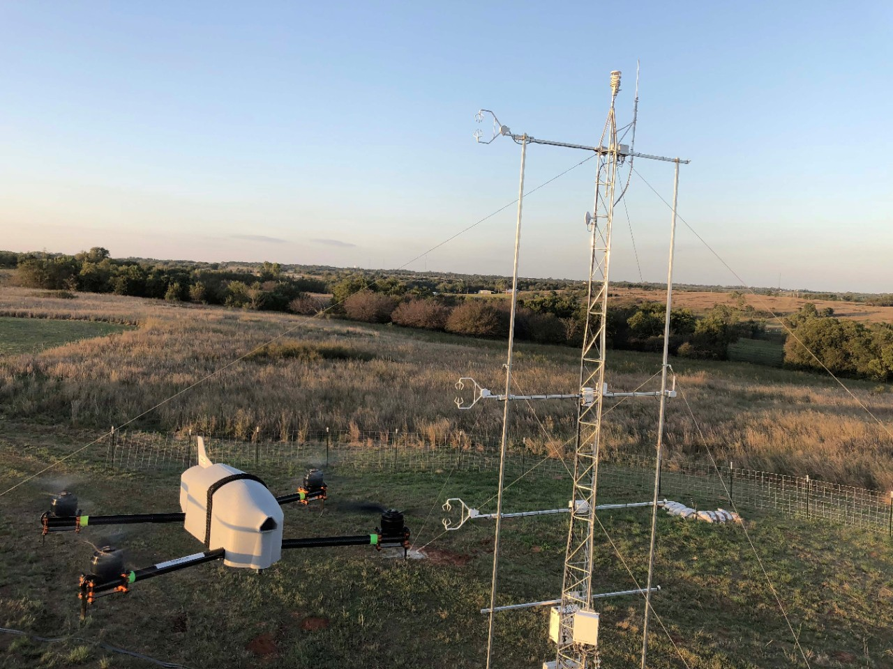 The CopterSonde aircraft is being flown next to a meterological tower