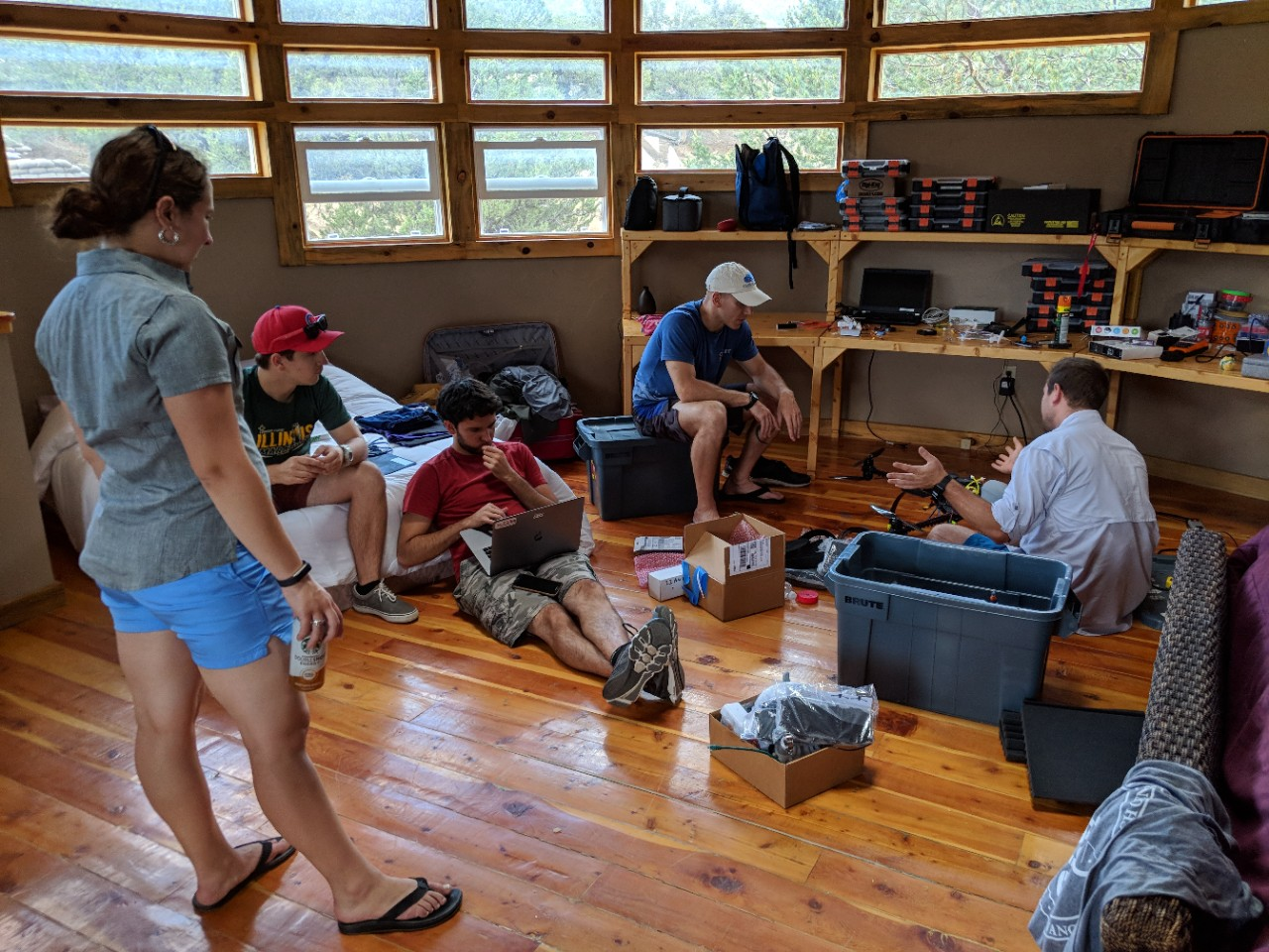 team of researchers discussing UAS operations - A team of CASS researchers discussing a plan for the next morning's observations in a makeshift engineering laboratory during a field deployment to San Luis Valley, CO as a part of the LAPSE-RATE campaign in July 2018.