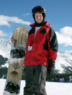 Joel Maupin on ski slope with snowboard