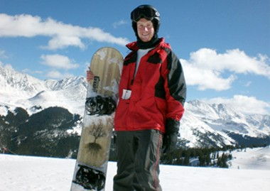 Joel Maupin with snowboard on ski slope