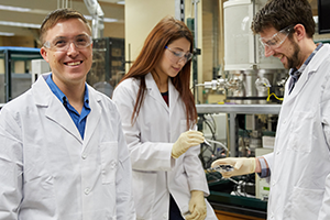 Steven Crossley in lab with students