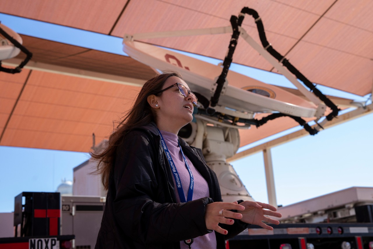 An A&GS student gives a tour of the National Weather Center Vehicle Bay in November, 2019.