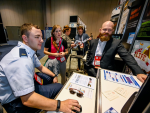 "Emmett Mathews, art director of the K20 Center's Game-Based Learning team, demos ""Get a Life"" at the Serious Games Showcase and Challenge, held in Orlando earlier this month."