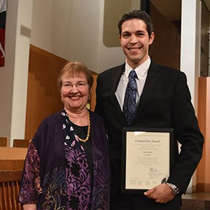 Adam Pajan of Monroeville, Pa., who is pursuing a doctor of musical arts degree in organ with church music emphasis at the University of Oklahoma, poses with Frances Nobert, president of the Board of Directors of the Mader Foundation.