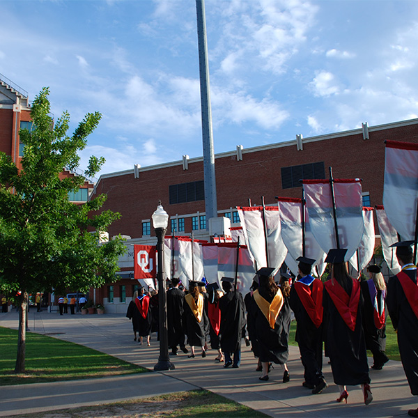 Students walking into the OU Commencement ceremony